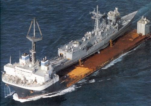 The heavy-lift ship MV Mighty Servant bears the damaged USS Samuel B. Roberts (FFG 58) on the journey from Dubai to Newport, R.I. (U.S. Navy photo)