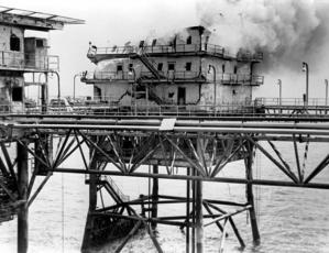 The main building of the Iranian Sassan oil platform burns after being hit by a BGM-71 Tube-launched, Optically-guided, Wire-guided (TOW) missile fired from a Marine AH-1 Cobra helicopter. The attack was part of Operation Praying Mantis which was launched after the guided missile frigate USS SAMUEL B. ROBERTS (FFG-58) struck an Iranian mine on April 14, 1988.