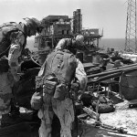 Marines inspect a ZU-23 23mm automatic anti-aircraft gun on the Iranian Sassan oil platform. Marines attacked, occupied, and then destroyed the platform. U.S. NAVY PHOTO BY CPL. JOHN HYP