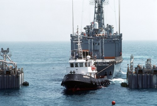 A tug pulls<i>Roberts</i>into position over MS2's cargo deck. Because of tolerances measures in inches, the loading will take some 12 hours. (U.S. Navy photo by PH2 Michael Harnar)