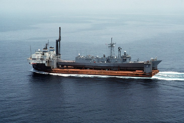 With a skeleton crew of about 40 sailors aboard, <i>Roberts</i>departs UAE waters, heading for the Strait of Hormuz on 1 July 1988. (PH2 Michael Harnar/U.S. Navy)