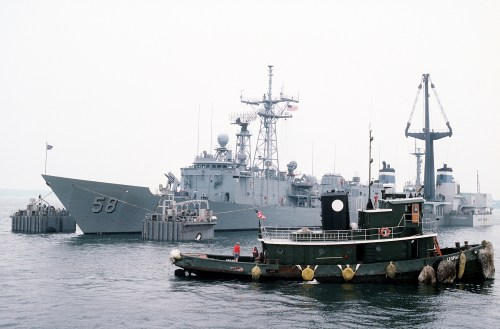 The Dutch salvage ship MIGHTY SERVANT II prepares to lift the guided missile frigate USS SAMUEL B. ROBERTS (FFG-58) onto its deck for transport back to its home port in Newport, R.I.  The frigate was damaged after it struck a mine in the Persian Gulf on 14 April 1988.