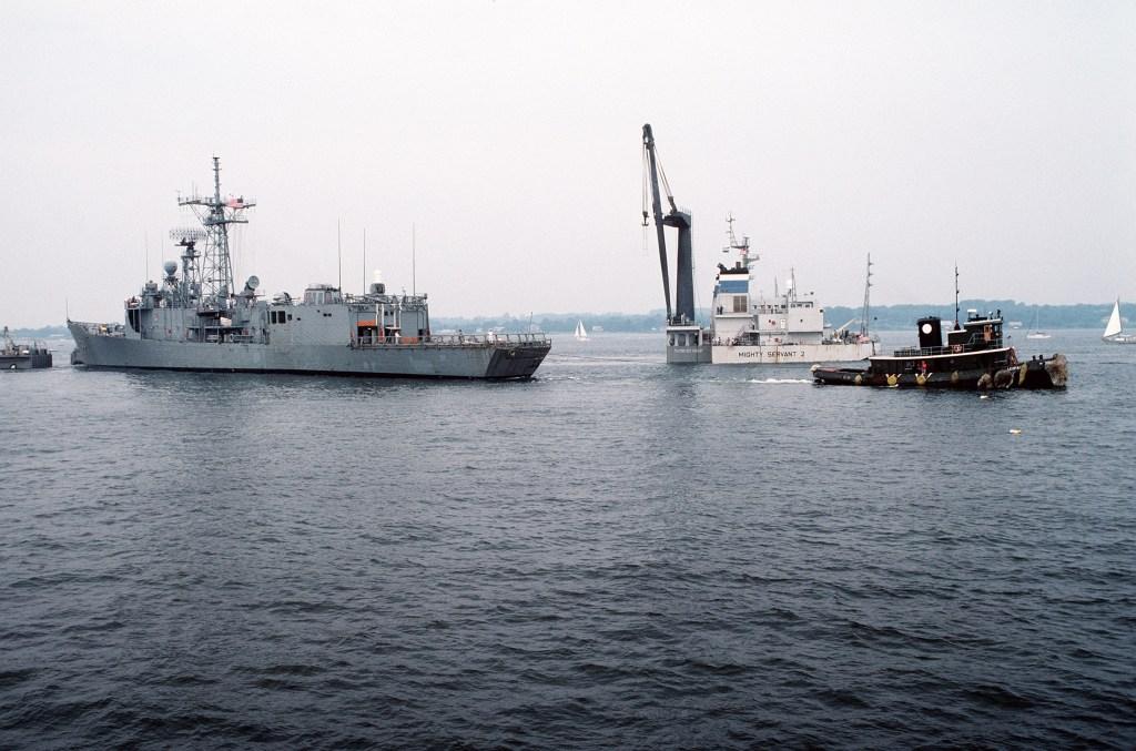 A tugboat pulls<i>Roberts</i>from the heavy-lift ship.(PH2 Elliott/U.S. Navy)