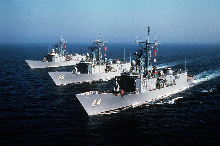 FFG 7 sails in formation with two sister ships, USS Antrim (FFG 20) and USS Jack Williams (FFG 24), on 1 July 1982. Six years later, Jack Williams would sail with USS Samuel B. Roberts (FFG 58) on its fateful deployment to the Persian Gulf. U.S. NAVY PHOTO