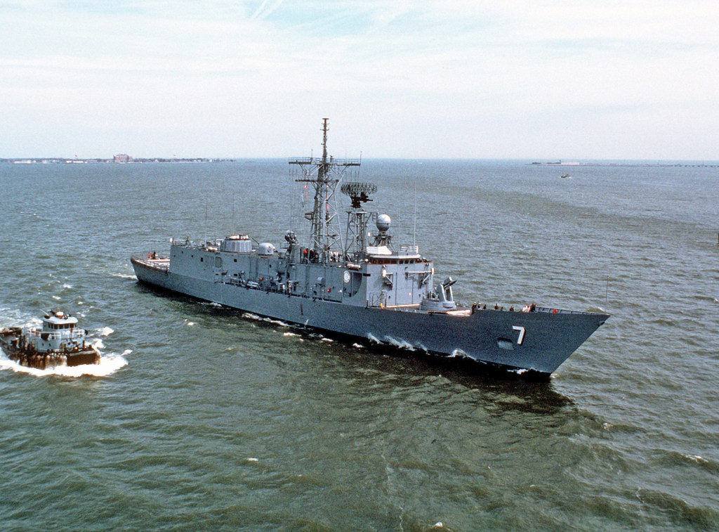 A starboard bow view of the guided missile frigate USS Oliver Hazard Perry (FFG 7) underway on 24 Aug 1979 in the Great Lakes. U.S. NAVY PHOTO BY PHC FRANCAVILLO