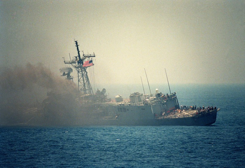 A port quarter view of the guided missile frigate USS STARK (FFG 31) listing to port after being struck by an Iraqi-launched Exocet missile.