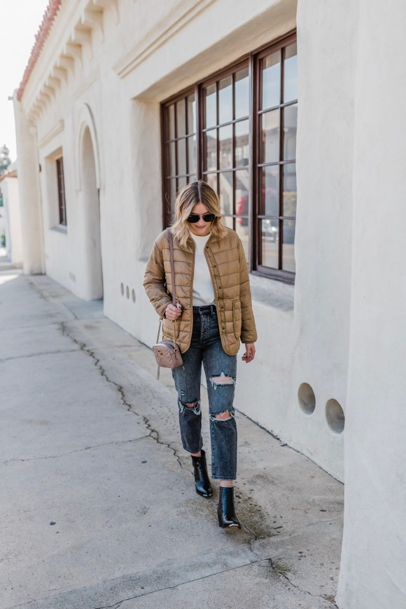 THE 25 BEST WINTER COATS AND JACKETS FOR WOMEN by popular fashion blog, Navy Grace: image of a woman outside wearing an Everlane The ReNew Channeled Liner, Urban Outfitters BDG High-Waisted Slim Straight Jean, Nordstrom Vince Camuto Anikah Pointy Toe Bootie, Nordstrom Gucci GG Marmont 2.0 Matelassé Leather Shoulder Bag, and ShopBop Le Specs Echo Sunglasses.