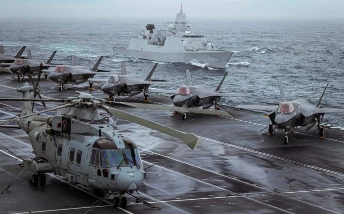 https://i0.wp.com/www.navylookout.com/wp-content/uploads/2020/12/HNLMS-Evertsen-Escorting-HMS-Queen-Elizabeth.jpg?resize=696%2C434&ssl=1