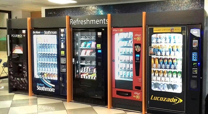A row of vending machines encourages complementary food pairing. One tip for upselling items in the unattended machine market.