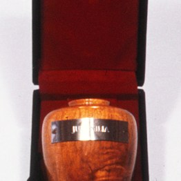 Marginalia/Juvenalia, 1986, turned wooden vase with stamped metal and display box, 7 x 5 x 4 inches