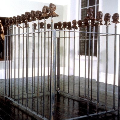 Chocolate Wagner Busts, 1993, wood, metal, 31 chocolate busts, approximate 7 x 8 x 5 inches, overall 96 x 171 inches
