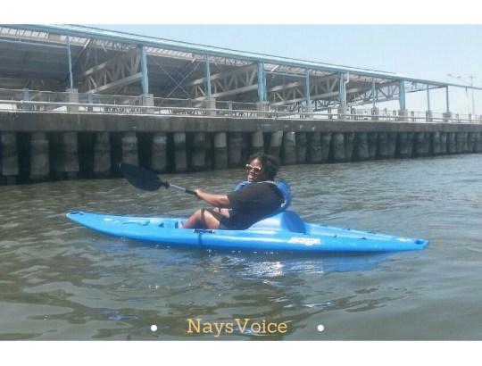 plus size women kayaking on blue kayak
