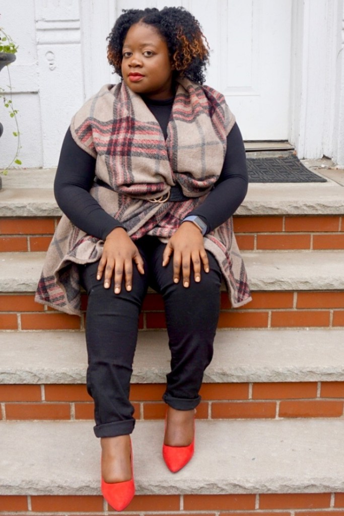 plus size Black girl sitting on steps wearingRed Rosewell Pump by Kelly and Katie