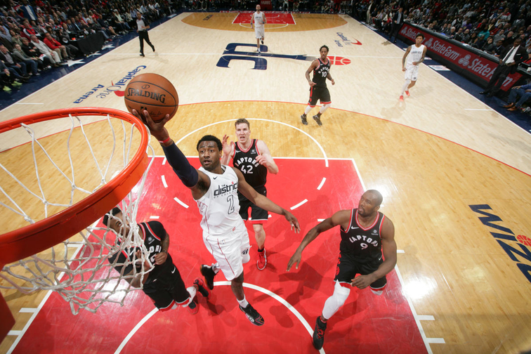 Washington dc april john wall of the wizards goes to basket against toronto raptors in game four round one nba also season on line with friday rh