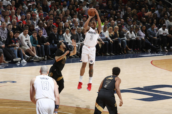 Washington dc april bradley beal of the wizards shoots ball against toronto raptors in game six eastern conference also take series end  season rh nba