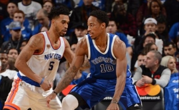 Courtney Lee y DeMar DeRozan