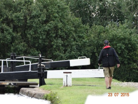 Leaving the Llangollen through Hurleston Locks. Me at the tiller and Charlie lock wheeling!