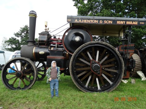 Steam engines. Don't know who the boy is; he interloped into the photo