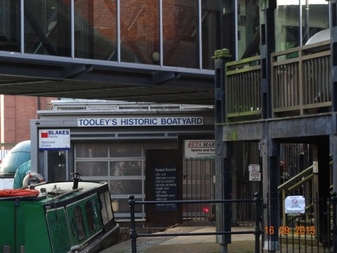 Passing Tooleys historic boatyard which is partly hidden among the shopping centre development