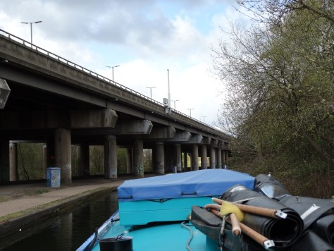 The start of spaghetti junction with the cars and lorries flying along above