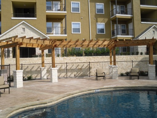 Wood and Stone Patio Cover with Gates and Fence