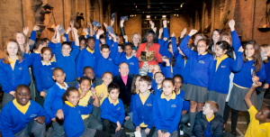 Anoria Simmons, (in red and holding trophy) with her students and fellow teachers after receiving her award in London. Photo: courtest Harry Potter studio and the BBC