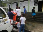 NBC Radio distributing t-shirts to persons in shelters on the Leeward side of the country.