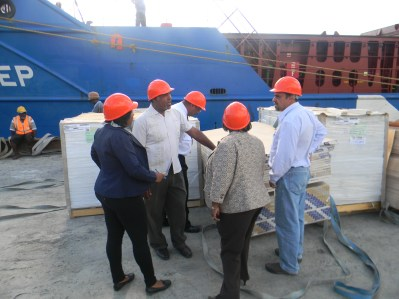 The process of offloading about five million dollars in Building material which arrived in the state today via boat from Jamaica-based hardware firm Tank Weld.
