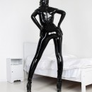 black_latex_rubber_girl_in_a_white_room__4_by_agnadeviphotographer-d4gg6jz