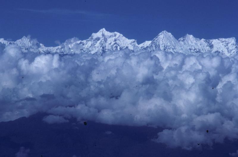 himalayan peaks above cloud