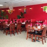 Bright red dining room at Himalayan Range Nepali