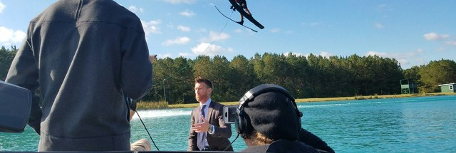 Santiago Varas jumps in the background of ESPN video shoot.