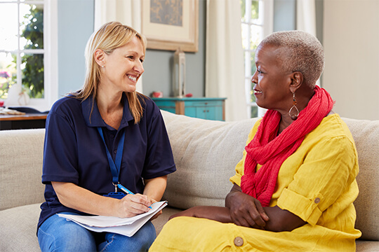carer talking to woman