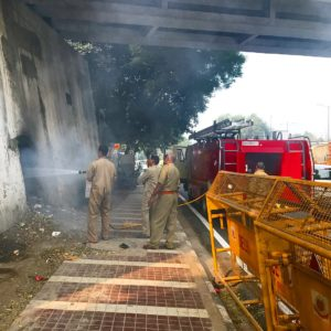 Extinguishing the man made fires. New Delhi Nature Society NGO makes sure that the city can breath cleaner air. Stopping smoke in every possible way.