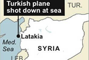 Turkey threatens action after Syria downs jet