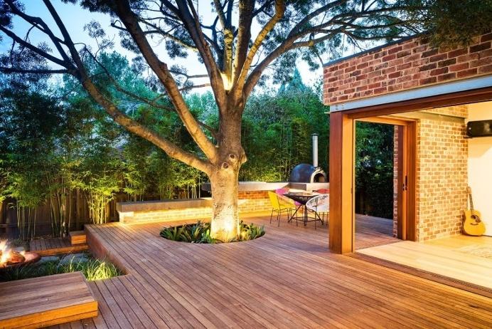 wooden deck around the tree