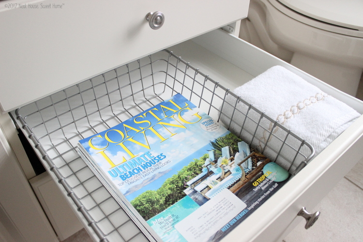 Shabby, coastal, beachy, nautical, and laid back. A kid friendly cottage chic guest bathroom makeover very easy to pull off with just a few changes.