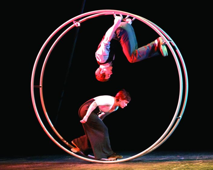 photo of two people performing a duo german wheel act on stage