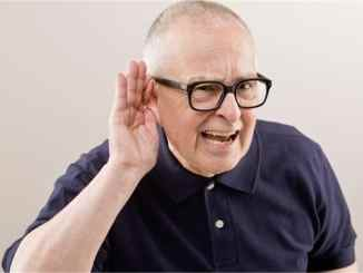 old man having hearing loss
