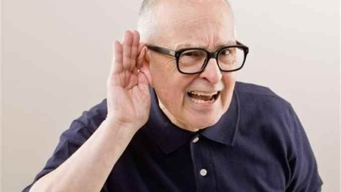 old man having hearing loss