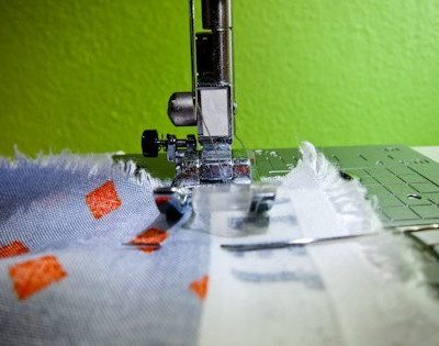 Sew at a 5/8 seam allowance using a straight stitch. Back stitch at the beginning of your stitch and the end