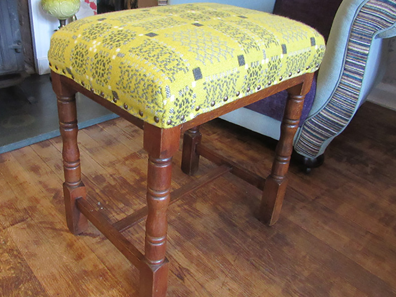 The 'after' picture of repaired woodwork on the wobbly welsh stool