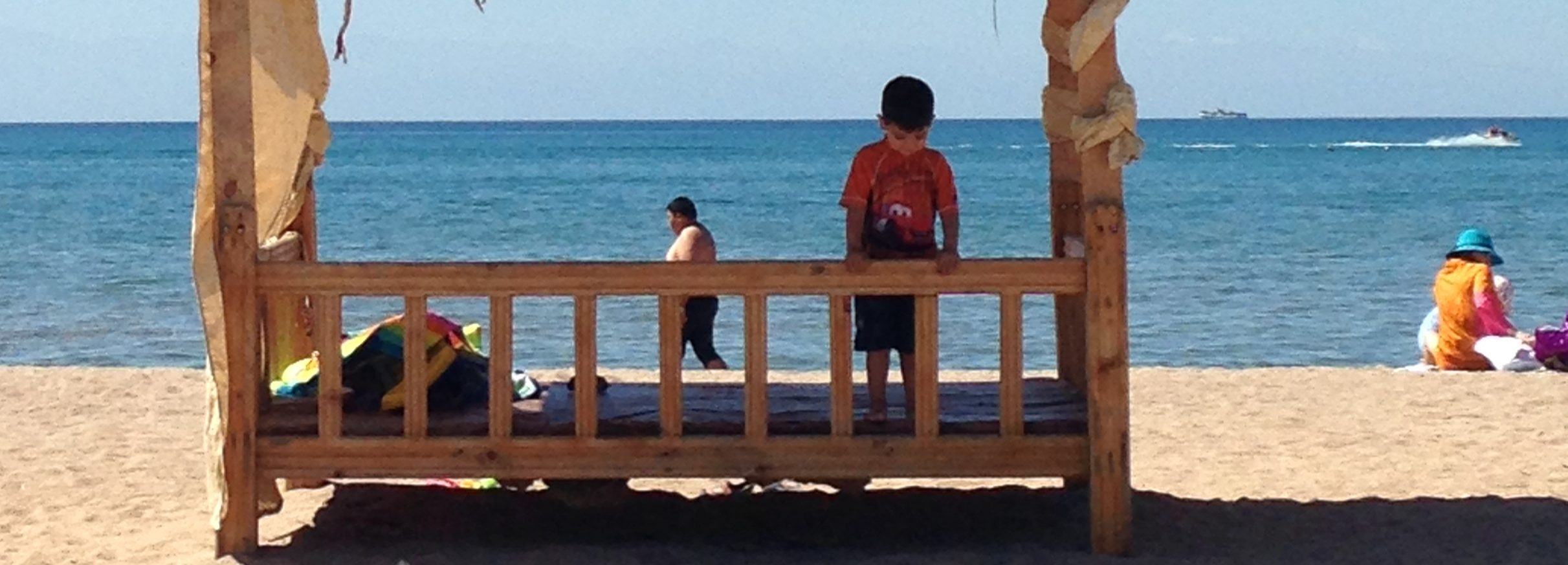 boy looking at sand