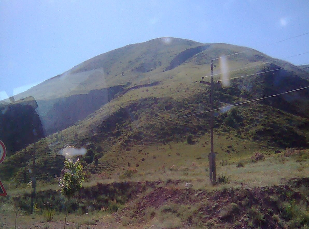 a hill seen through a car window