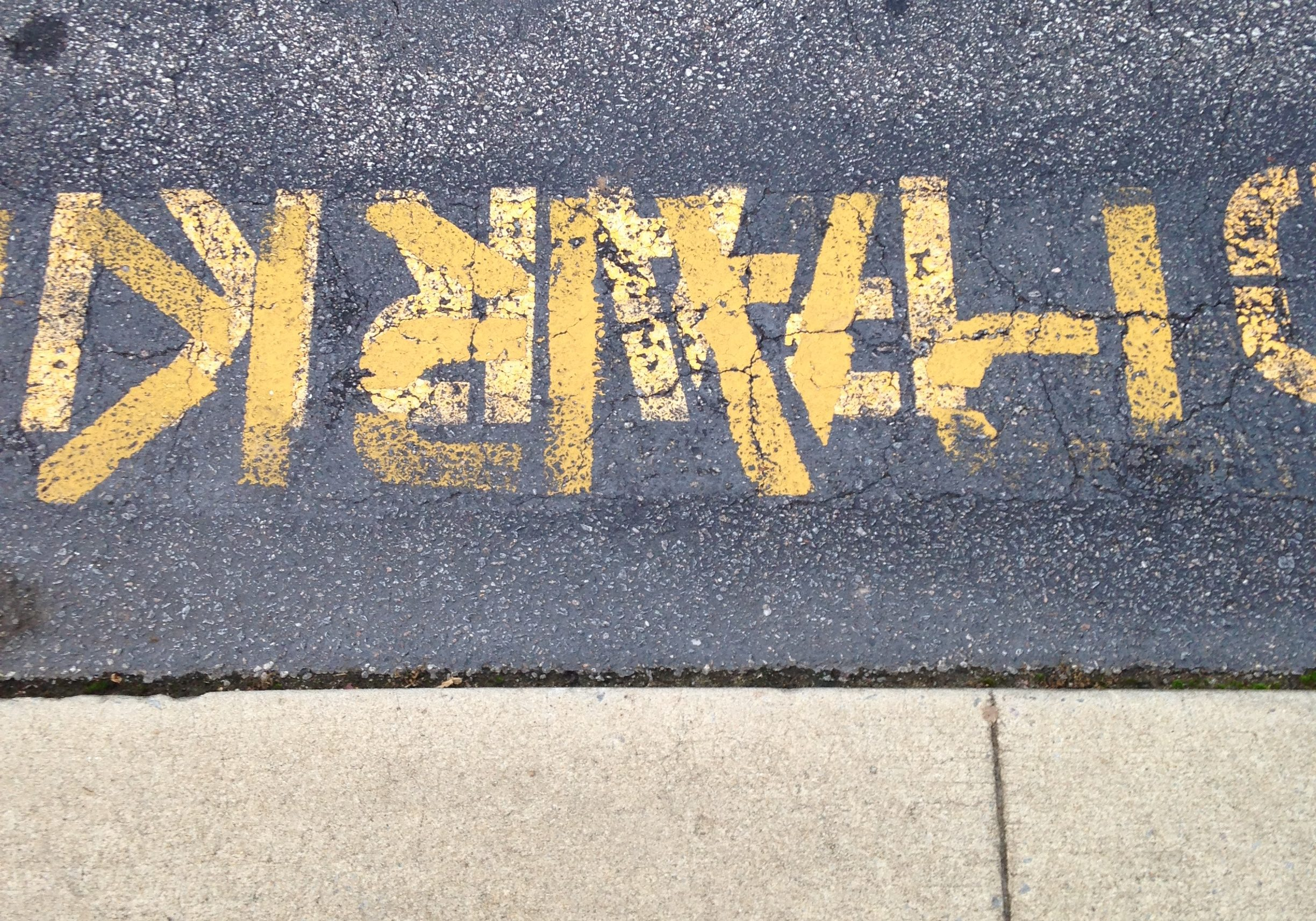 stencils letters on pavement that cant be read