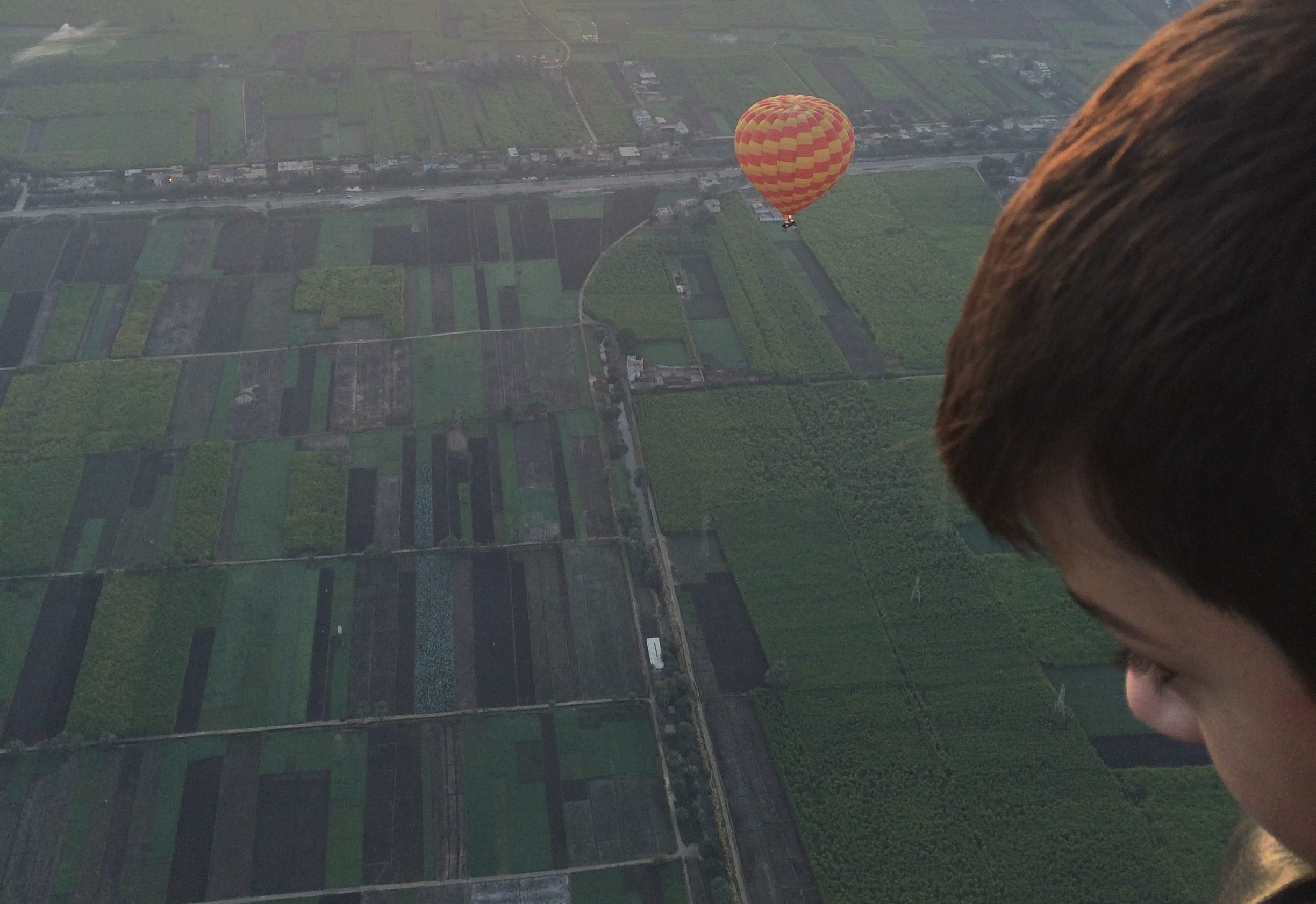 preteen staring out of a hot air balloon