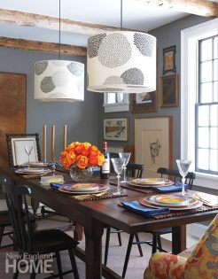 "The dining room's dark walls ""make things pop,"" explains the designer."