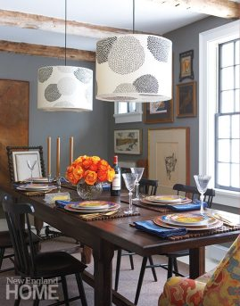 "The dining room's dark walls ""make things pop,"" explains the designer."
