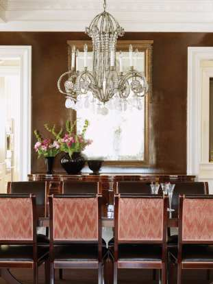 A light palette is used throughout the house except in the dining room, where chocolate-glazed walls add drama.