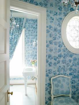 """The elegant powder room is swathed in blue floral fabrics. """"I wanted to make it a jewel box,"""" says Griffin-Balsbaugh."""